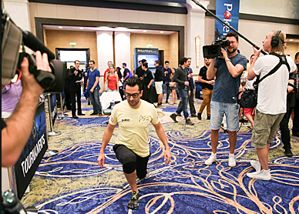 Antonio Esfandiaria lunges before taking a quick piss under the poker table