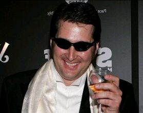 Phil Hellmuth sips bubbly on the red carpet